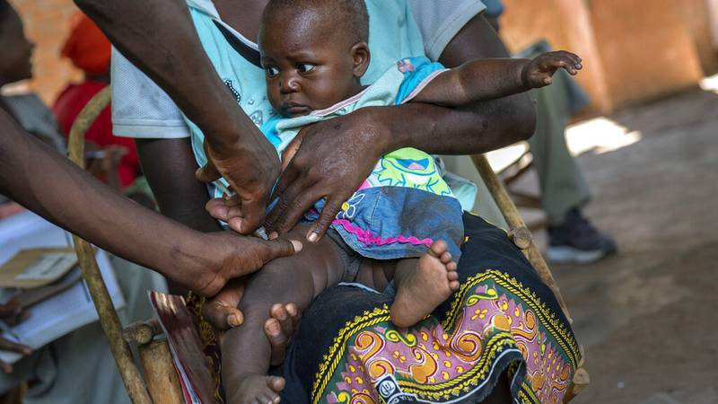 FILE - A baby from the Malawi village of Tomali is injected in 2019 with malaria vaccine.