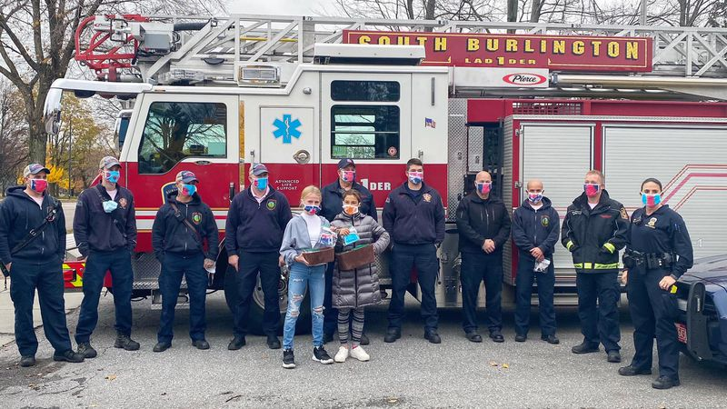 South Burlington middle schoolers, Sierra Rainey and Reese Gordon, donated masks to local...
