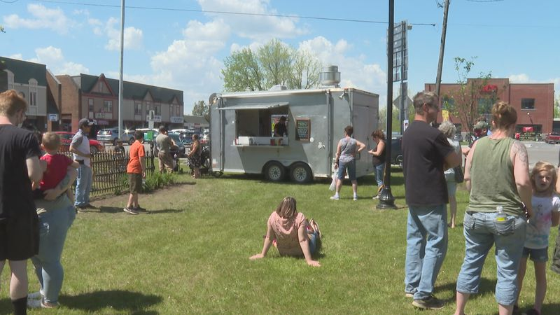 Food trucks and vendors sell their products at Swanton's inaugural event.