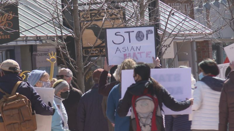 Dozens march through downtown Burlington, calling for an end to Asian hate crimes.