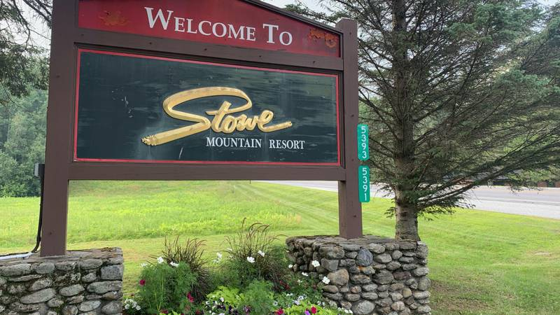 A sign welcomes visitors to the Stowe Mountain Resort in Stowe, VT.