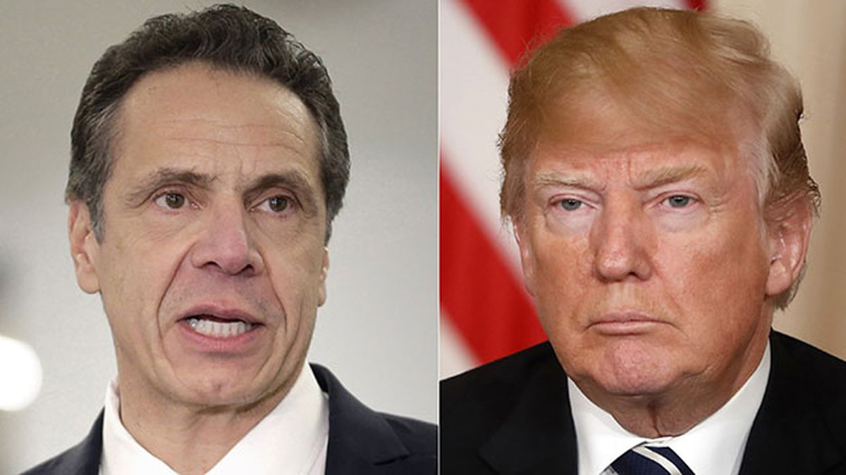 This combination of two file photos shows New York Gov. Andrew Cuomo on Feb. 14, 2019, and President Donald Trump on April 17, 2018. New York's Democratic governor told reporters Wednesday, Feb. 26, 2020, that the Republican president is punishing blue states, including New York, over their politics as the president runs for re-election. (AP Photo/Seth Wenig, Cuomo; Pablo Martinez Monsivais, Trump, File)