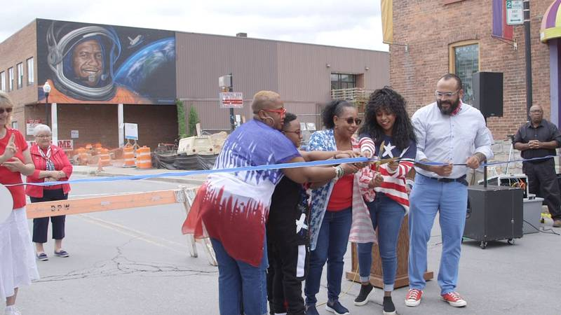 Michael Anderson's family attends the dedication for the mural in his honor in Plattsburgh.