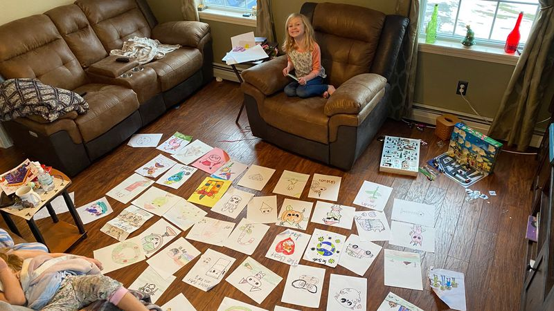 Eight-year-old Savannah Webber surrounded by her art.