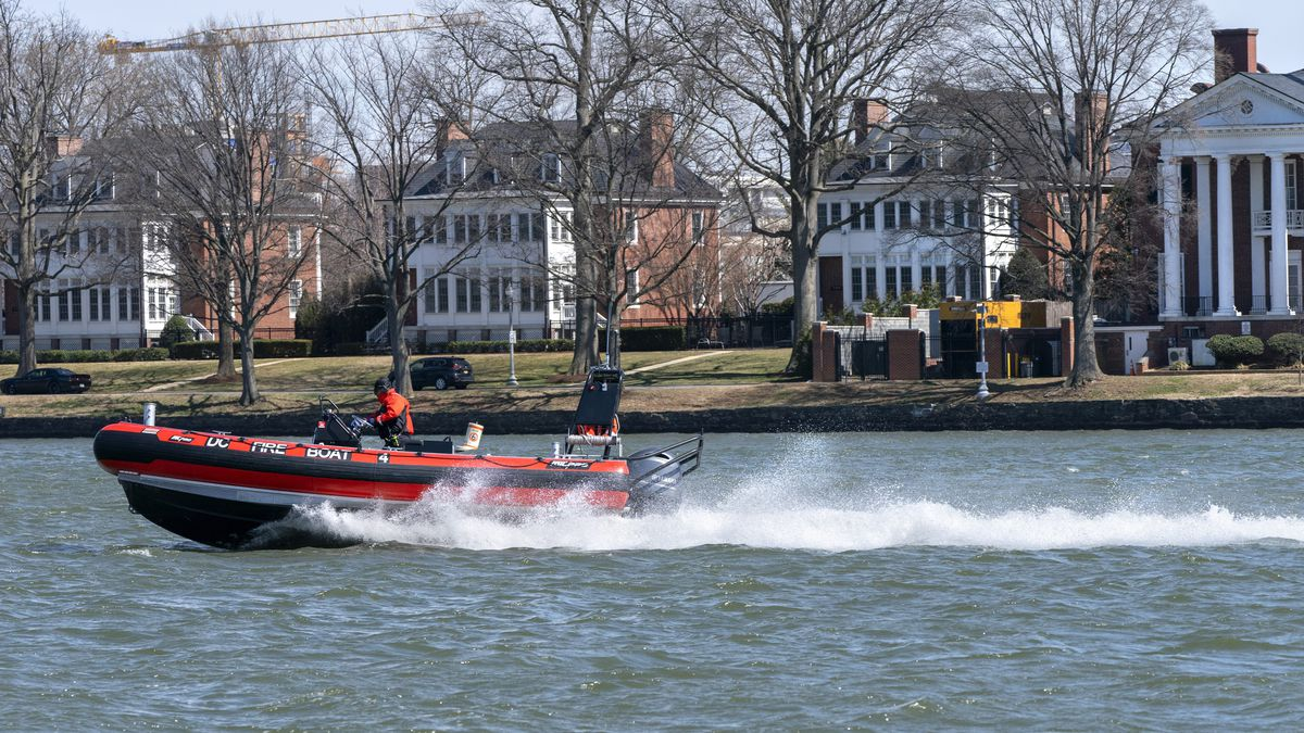 In this Friday, March 19, 2021 photo, a District of Columbia Fire Boat checks buoys in the...
