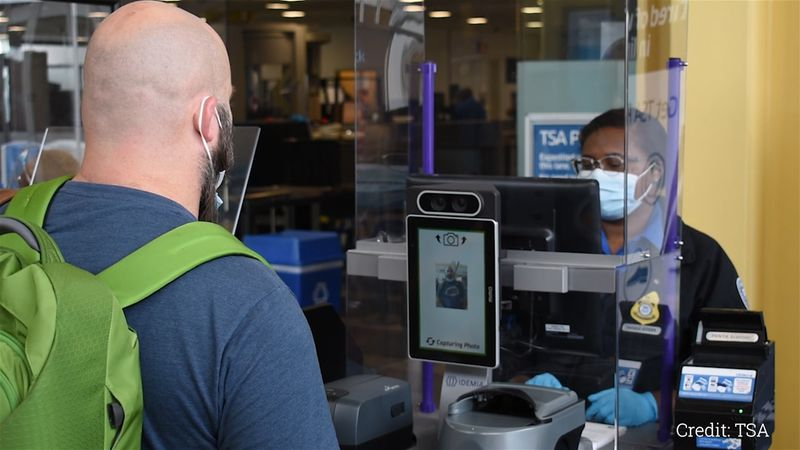 Facial recognition is currently being tested by volunteers at Reagan National Airport security...
