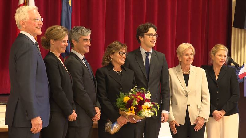 Lise Veronneau (center) has been named the new honorary consul of France to Vermont.