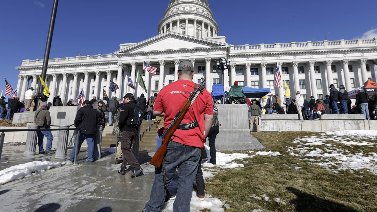 A man carries his weapon during a second amendment gun rally at Utah State Capitol on Feb. 8,...