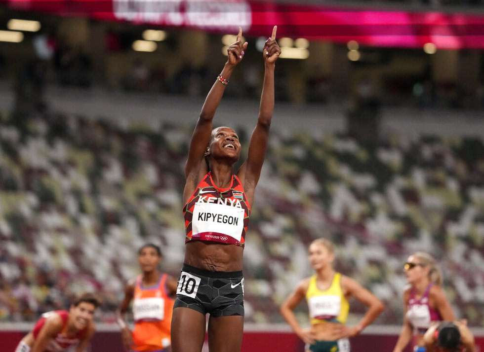Faith Kipyegon, of Kenya celebrates after winning gold after the final of the women's...