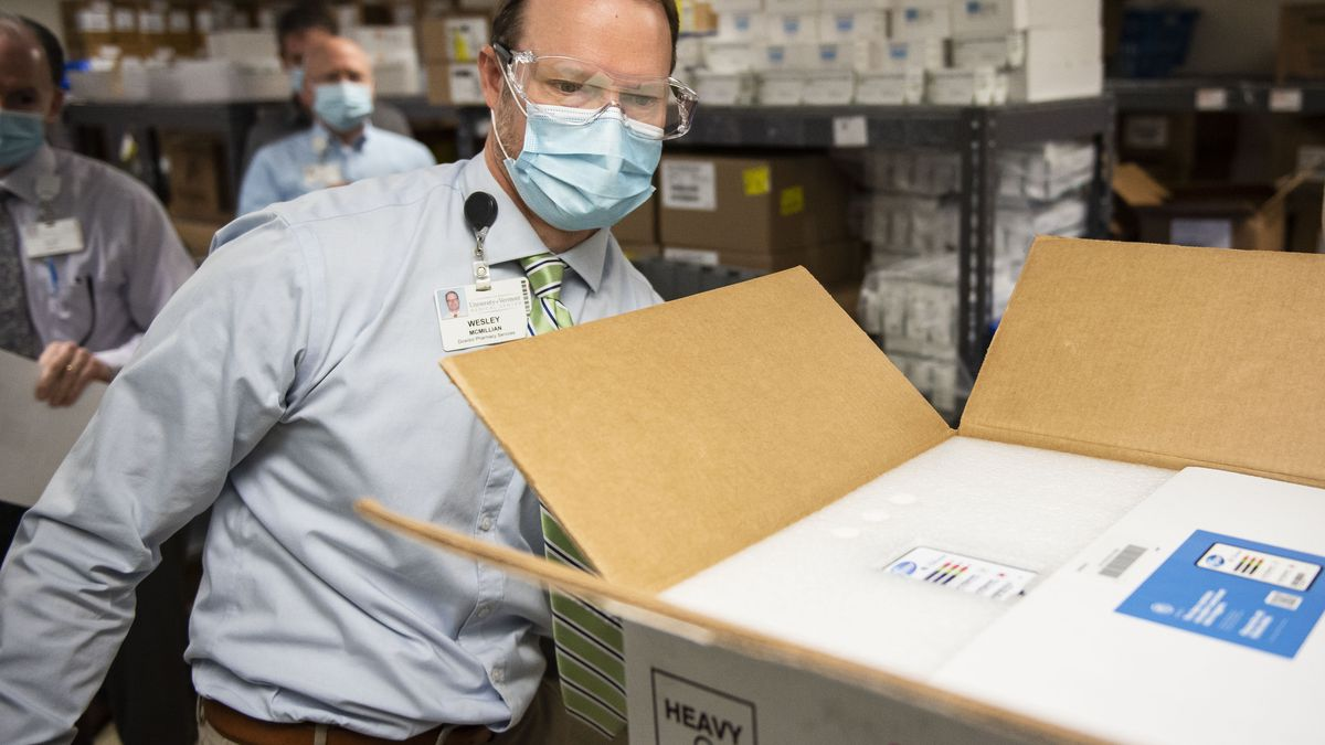 Wes McMillian, Director of Pharmacy Services, verifies the successful delivery of the Pfizer...