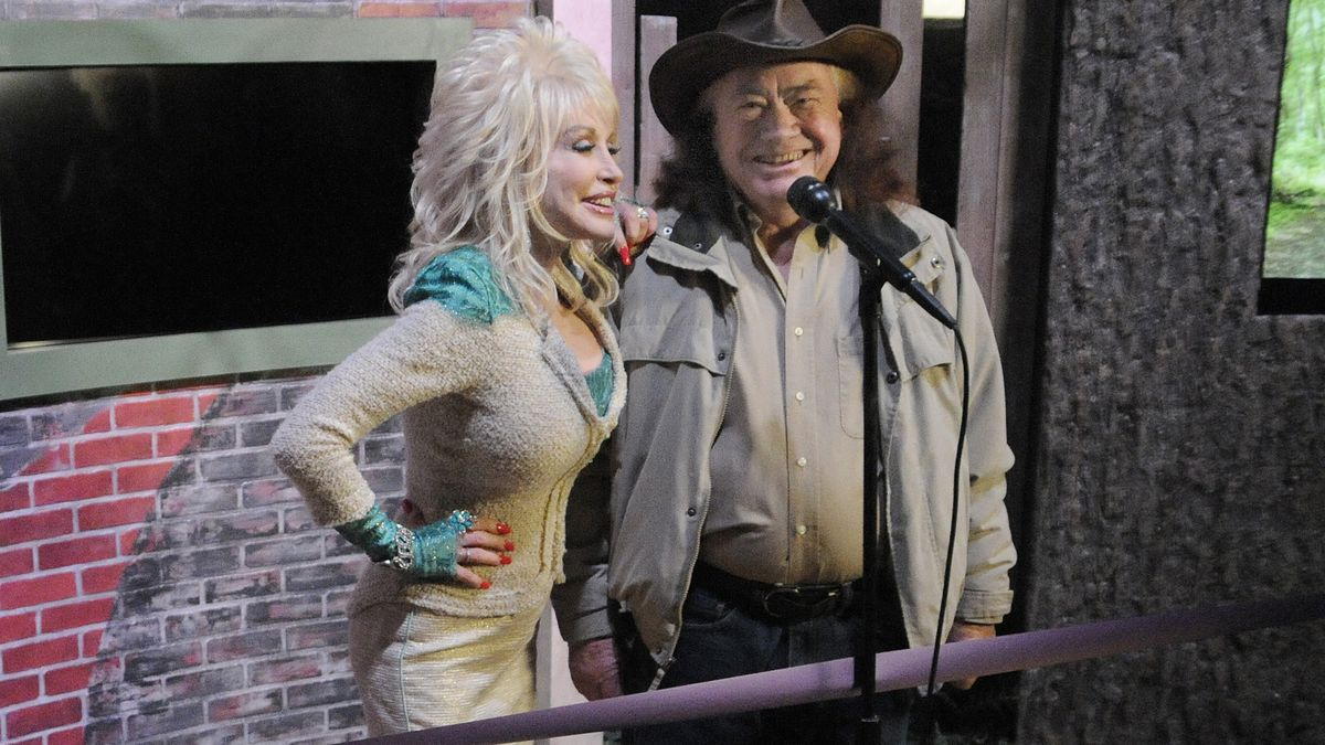 Country music legend Dolly Parton, left, stands with her uncle Bill Owens during a sneak peek...