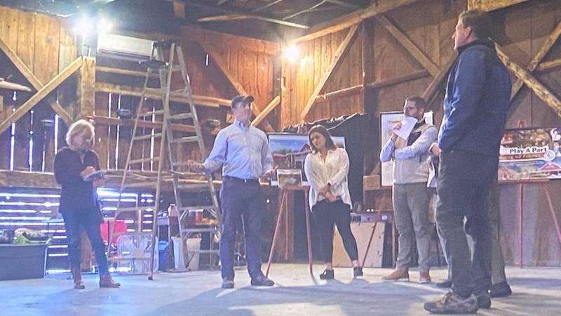 Gov. Chris Sununu tours the New London Barn Playhouse Thursday.