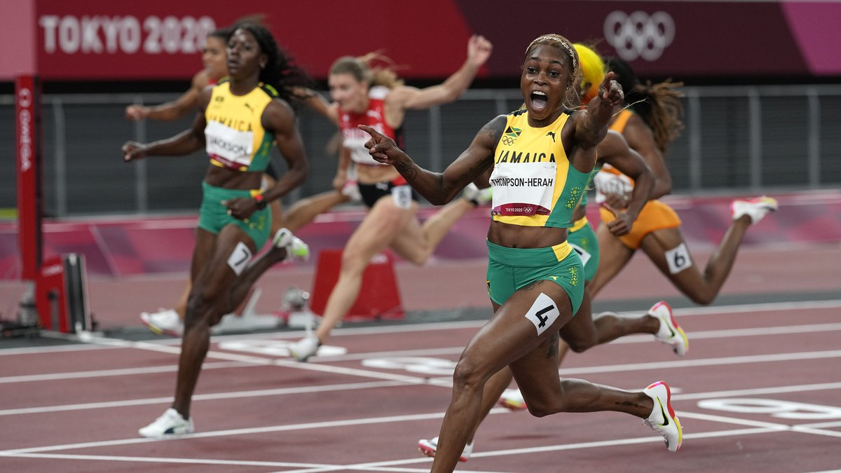 Elaine Thompson-Herah of Jamaica, celebrates as she wins the women's 100-meters final at the...