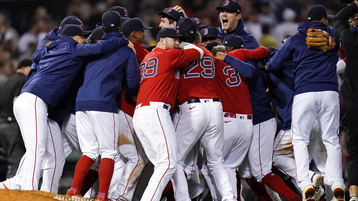 The Boston Red Sox celebrate after they defeated the New York Yankees 6-2 in an American League...