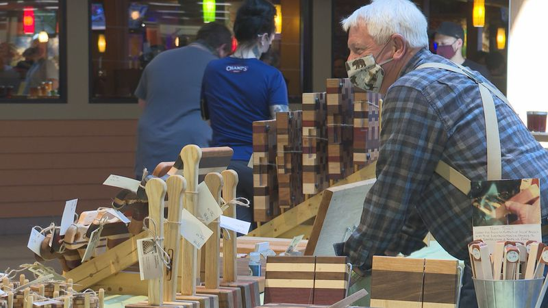 Scott Ross of Scott Ross Woodworking sells his goods at the UMall craft fair Saturday.