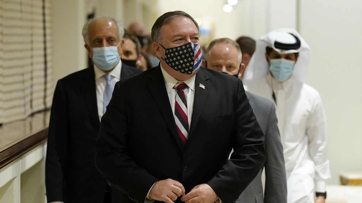 Secretary of State Mike Pompeo walks into a meeting with the Taliban's peace negotiation team...