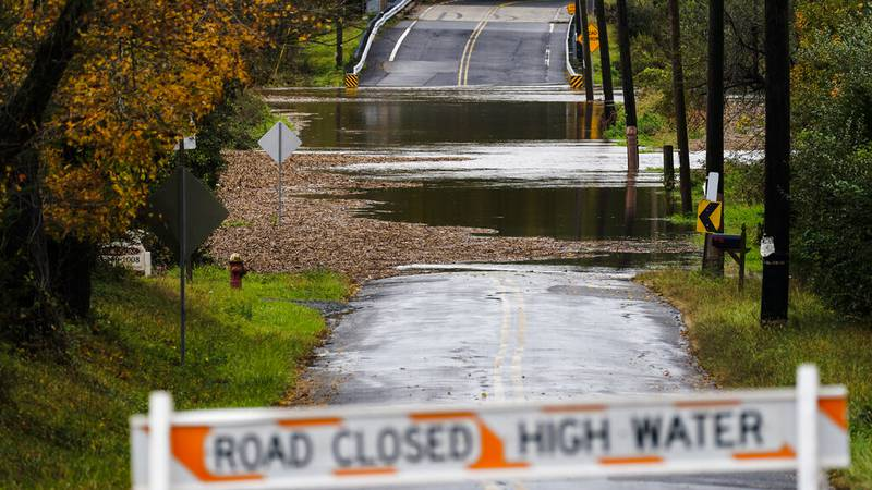 A barricade blocks access to a road flooded by recent rain in Branchburg, N.J., Tuesday.