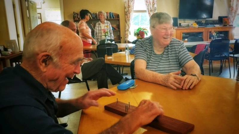 Visitors to the Twin Valley Senior Center in East Montpelier enjoying a return to normal.