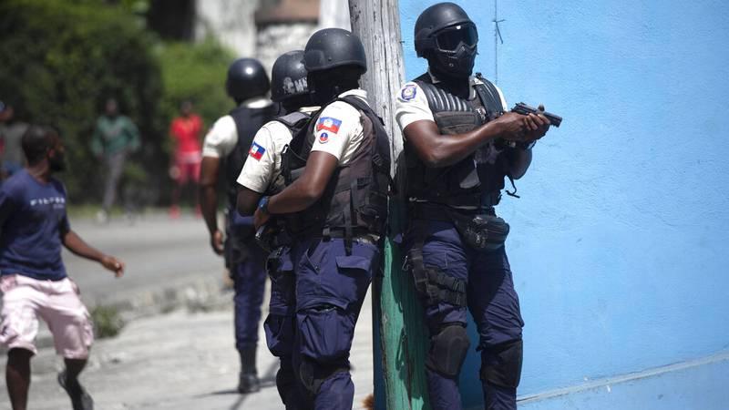 Police officers patrol in Port-au-Prince, Haiti, Thursday.