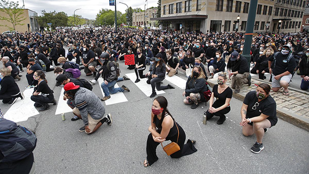 Demonstrators take a knee at a rally to peacefully protest and demand an end to institutional racism and police brutality, Wednesday, June 3, 2020, in Portland, Maine. (AP Photo/Robert F. Bukaty)