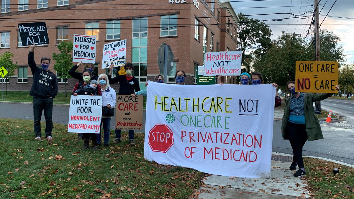 Advocates for making Medicaid more accessible and ditching the all-payer system held a picket Friday.