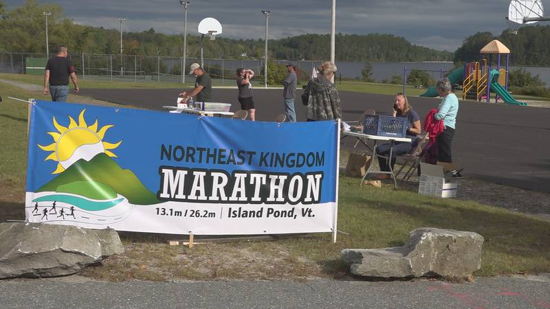 Runners check-in for the first ever Northeast Kingdom Marathon and Half in Island Pond