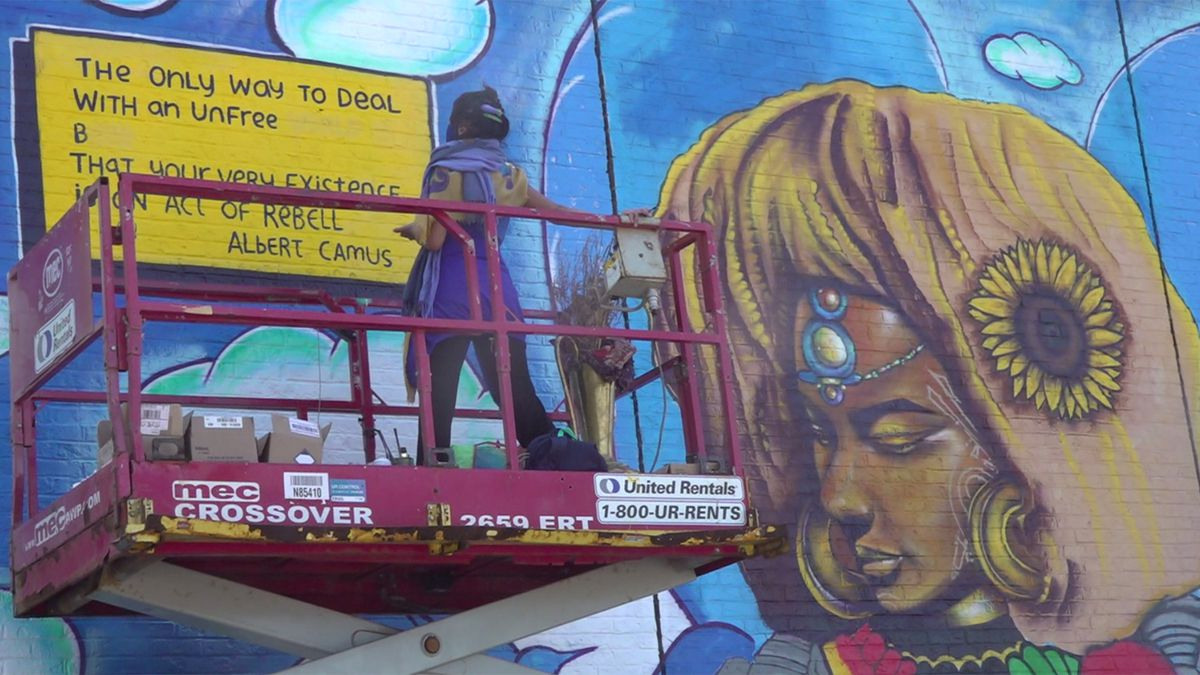 A mural in the south end of Burlington depicts a world where there is justice for all.