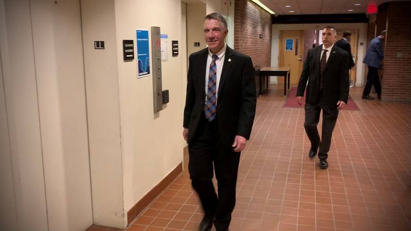 Gov. Phil Scott leaving Tuesday's briefing.