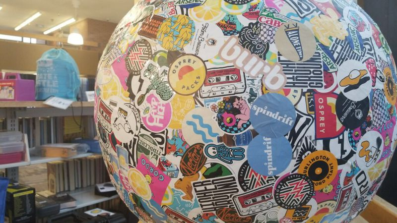 The world's largest sticker ball is on display in the window at the Fletcher Free Library in...