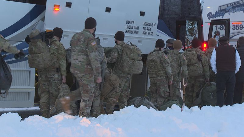 Vermont National Guard soldiers board four busses heading to D.C. Sunday.