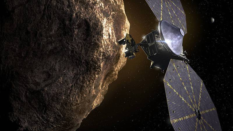 Artist's concept of the Lucy spacecraft encountering a Trojan asteroid.