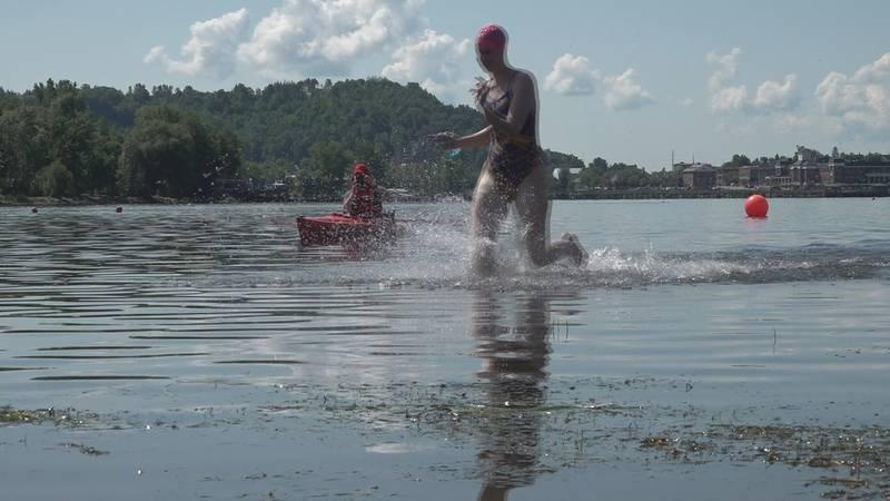 Swimmer runs out of Lake Memphremagog during the Kingdom Swim Saturday