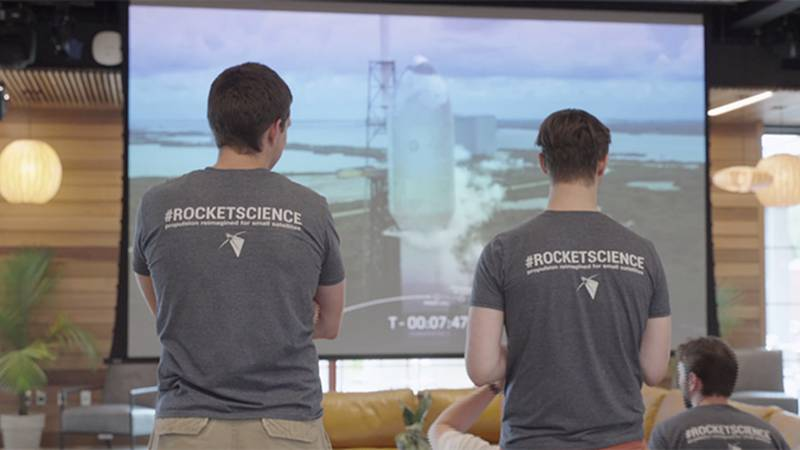Benchmark employees watch last week's SpaceX launch carrying satellites with the company's...