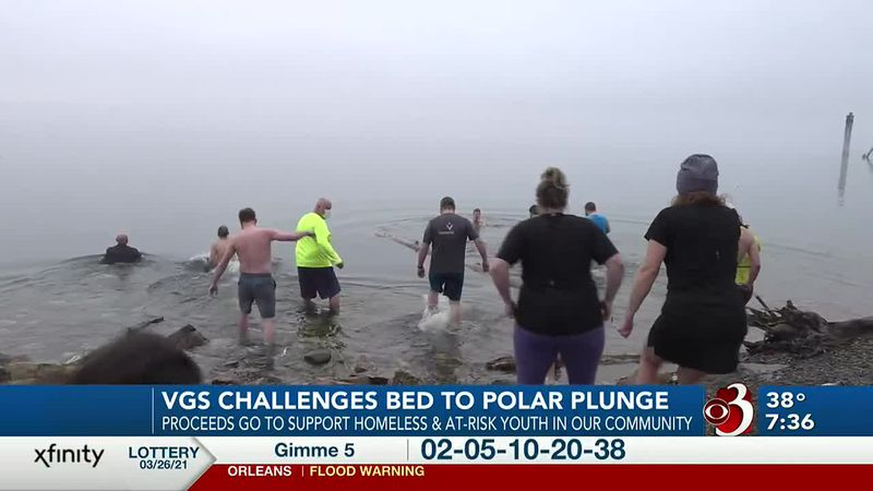 Two Vermont utility companys' employees take a bone-chilling dip to support kids in need.