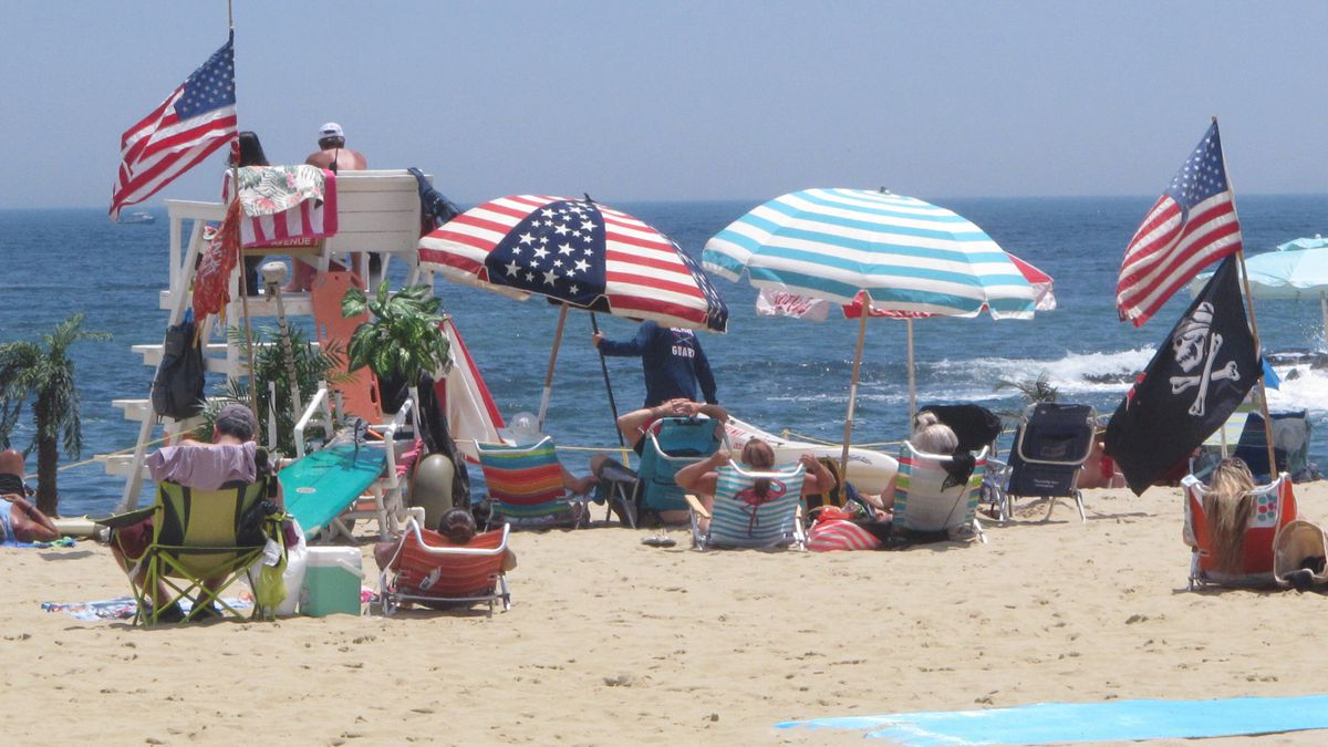 Flags line the beach in Belmar, N.J., on June 28, 2020. With large crowds expected at the Jersey Shore for the July Fourth weekend, some are worried that a failure to heed mask-wearing and social distancing protocols could accelerate the spread of the coronavirus.(Wayne Parry | AP Photo/Wayne Parry)