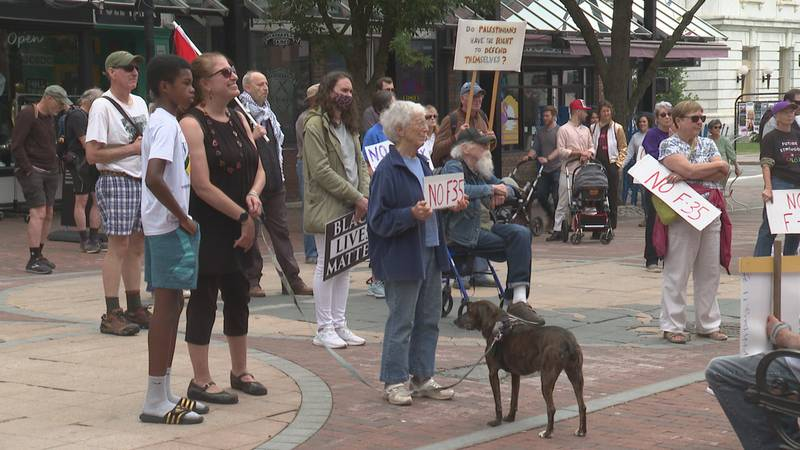 Activists gather outside Burlington City Hall Sunday for the launch of the Coalition of...