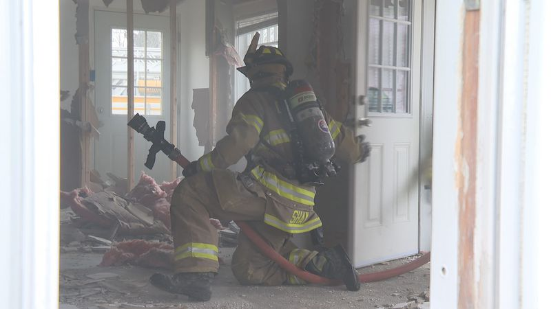 Firefighters participated in different drills, such as venting the roof, breaking windows, and...