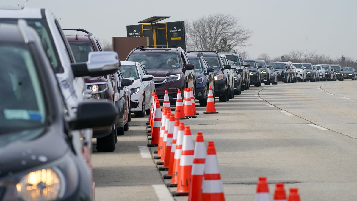 Cars line up to enter the New York State Nassau COVID-19 drive-through vaccination site.