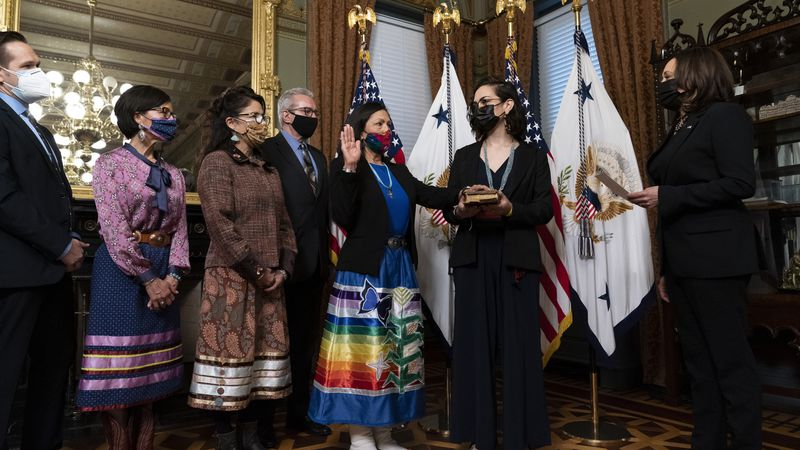 Vice President Kamala Harris, right, speaks during a ceremonial swearing in for Interior...