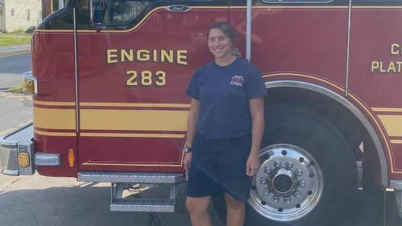 City of Plattsburgh firefighter Jenna Calandros poses in front of her new ride.