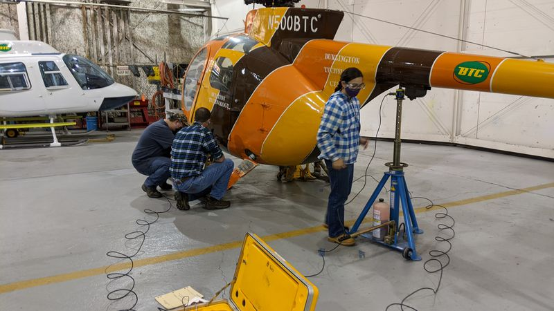 Students in Burlington Technical Center aviation program at work.