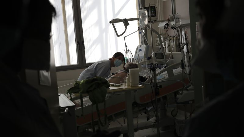 A nurse tends to a patient affected by COVID-19 virus in the ICU unit at the Charles Nicolle...