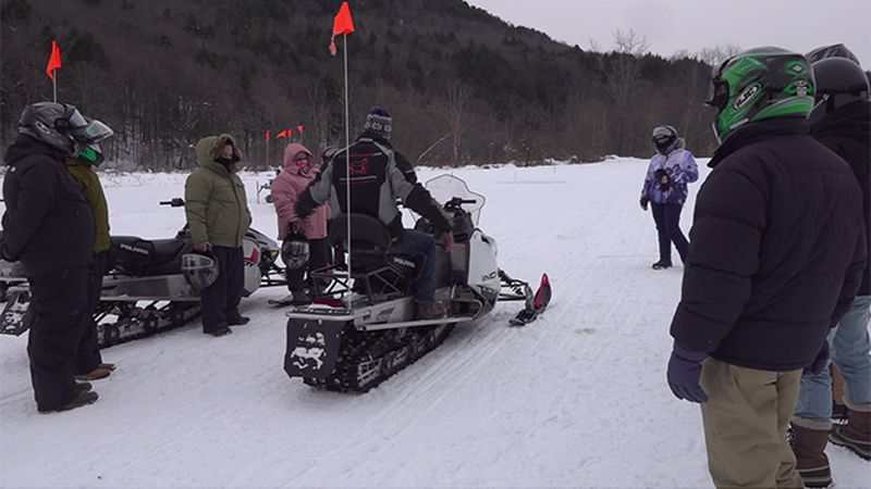Snowmobiile Vermont group prepares for tour in Stowe.