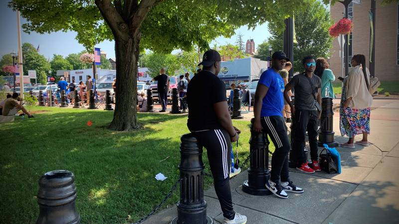 People in line outside the U.S. Passport Agency in St. Albans on Thursday.