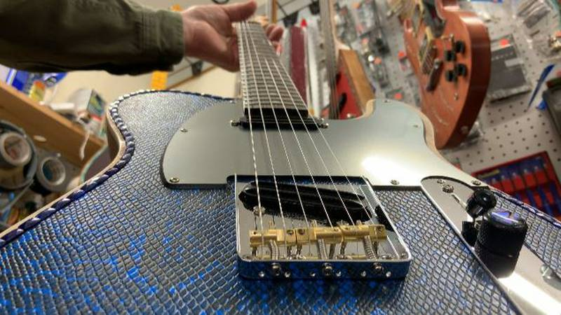 In his Windsor workshop, Neil Laurent spends his days building custom guitars with a serious...
