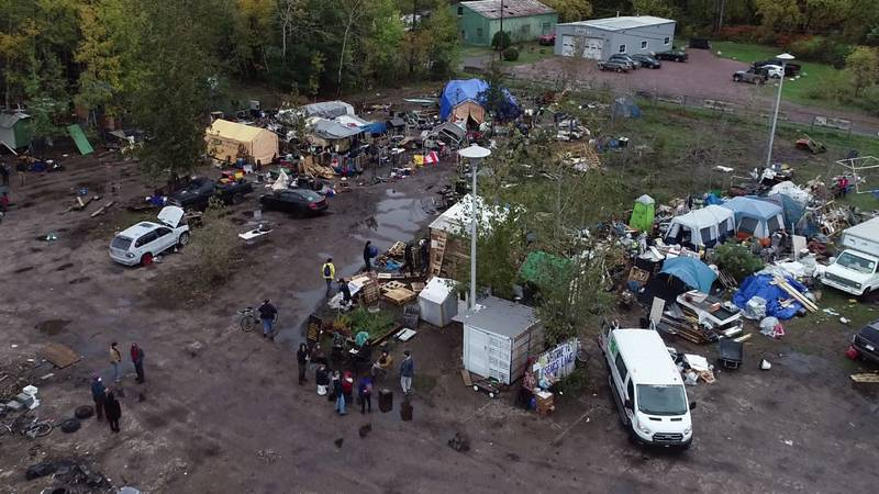 Over two dozen homeless living at the Sears Lane encampment in Burlington are on their way out.