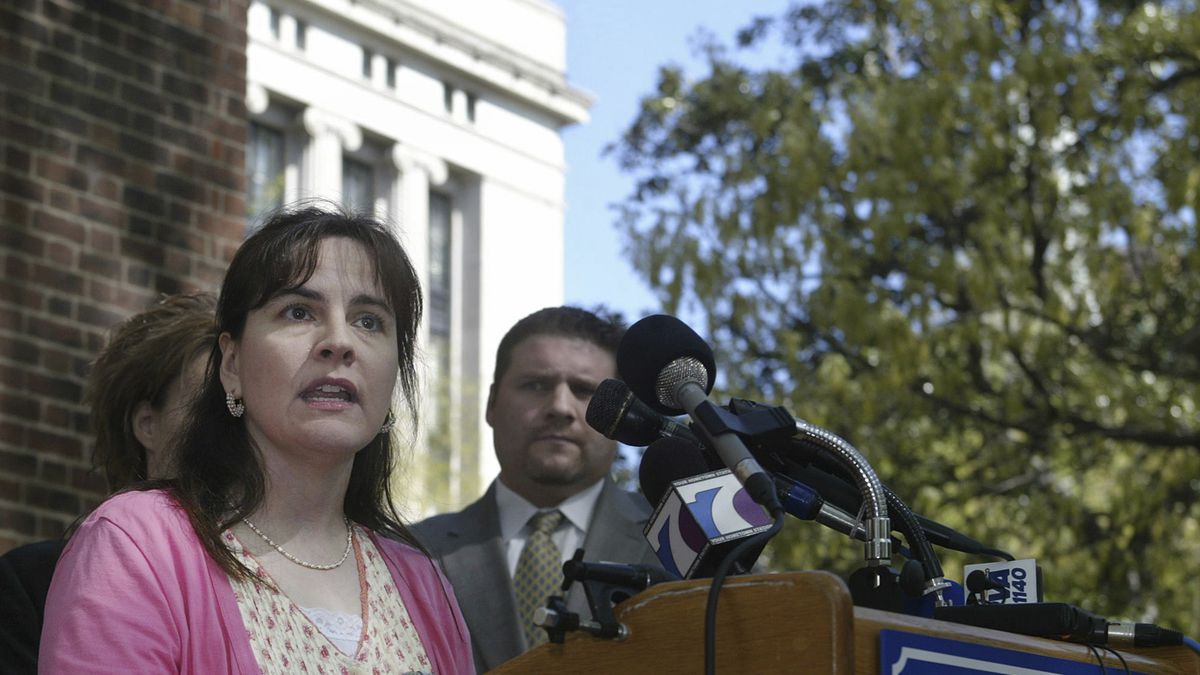 FILE -  Lisa Miller answers questions about her custody battle during a news conference at the...