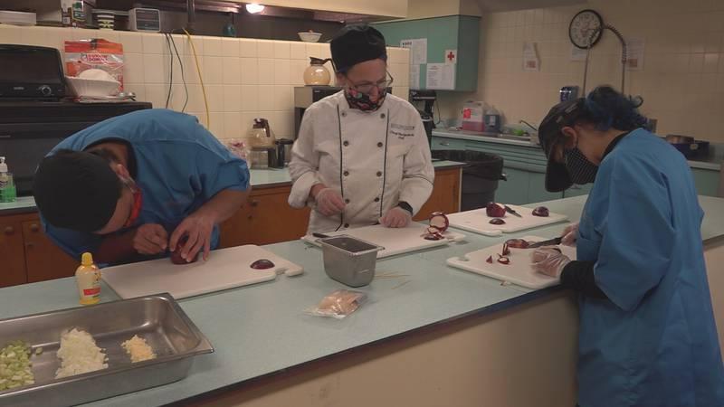 BTC culinary students at work Thursday at Saint Mark's Catholic Church in Burlington.