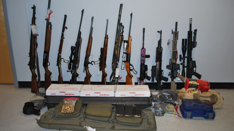 Nearly 20 guns have been taken from a man that police say wasn't even supposed to have any.