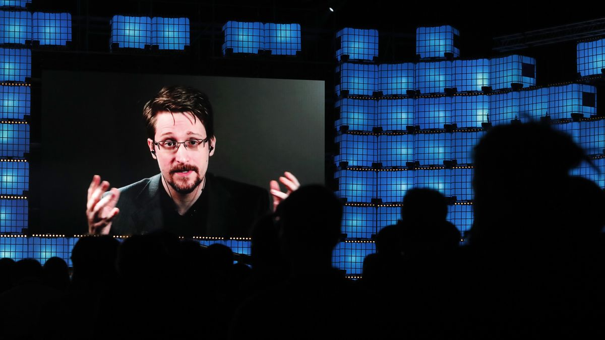 Former U.S. National Security Agency contractor Edward Snowden addresses attendees through...